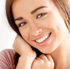 woman smiling vibrantly